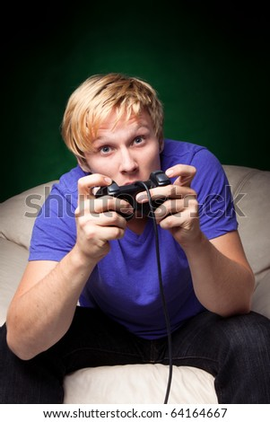 young man playing video games - stock photo