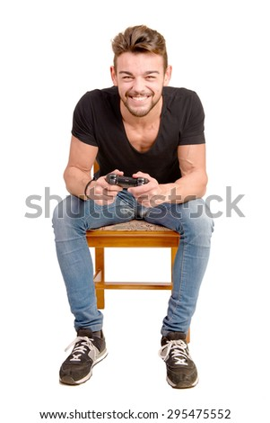 young man playing videogames isolated in white - stock photo