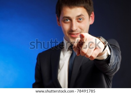 Young man pointing. - stock photo