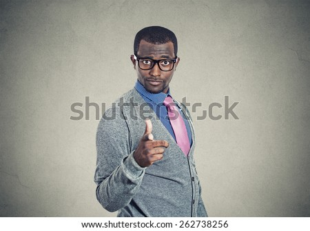 Young man pointing finger at you camera gesture  - stock photo