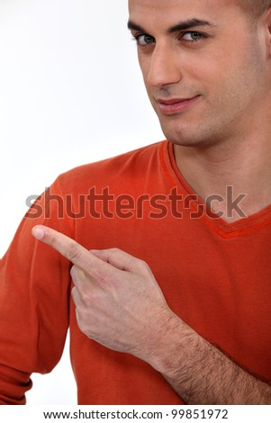 Young man pointing his finger