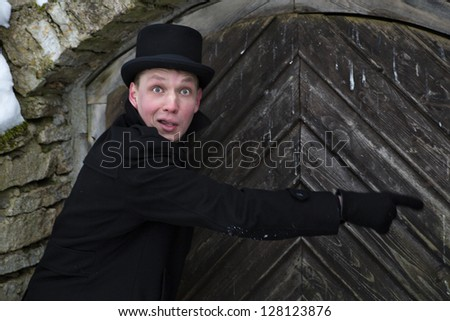 Young man pointing on door lock with surprise