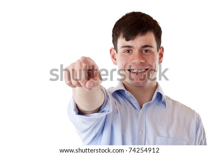Young man points to ad space in front.Isolated on white background. - stock photo