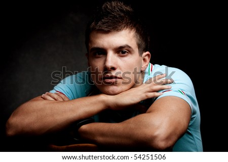 young man portrait, studio shot, dark background