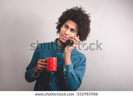 Young man portrait talking at the cell phone - stock photo