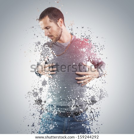 young man portrait with splash effect - stock photo