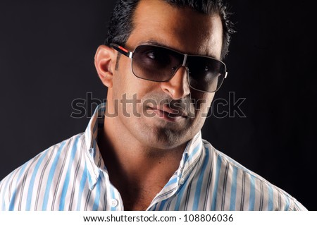young man posing against a black background - stock photo