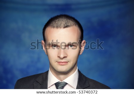 Young man posing on a blue background - stock photo