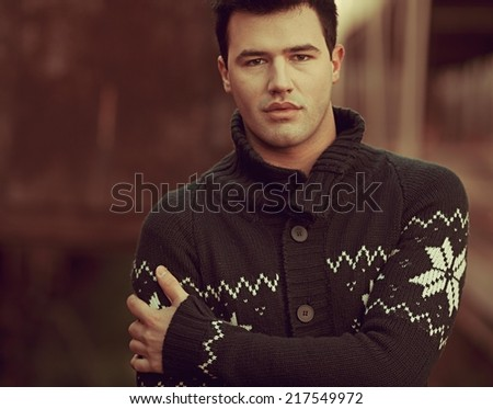 Young man posing outdoors. - stock photo
