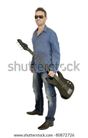 Young man posing with a guitar