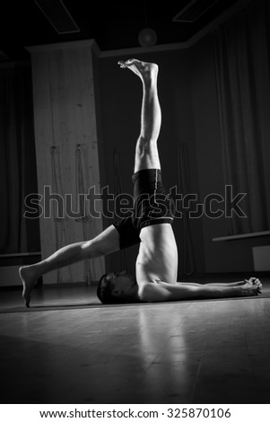 young man practicing yoga - stock photo