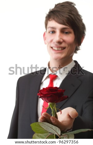 Young man presenting a flower - red rose isolated white background - stock photo