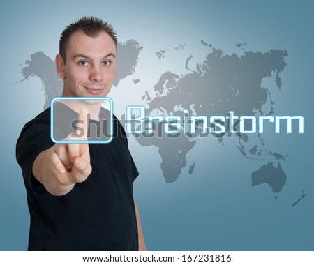 Young man press digital Brainstorm button on interface in front of him - stock photo