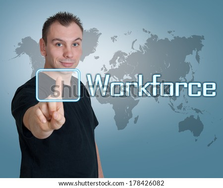 Young man press digital Workforce button on interface in front of him