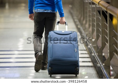 Young Man Pulling Suitcase Modern Airport Stock Photo