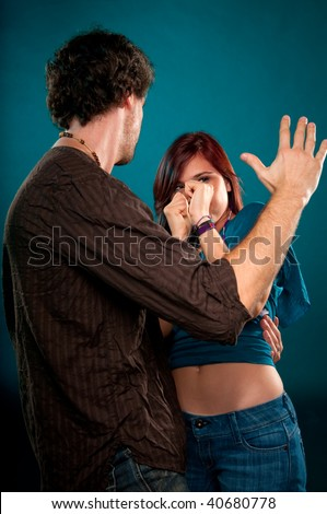 Young man punishing and attacking a young woman. - stock photo