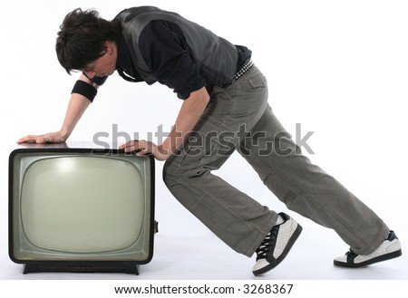 Young man push retro TV isolated on white. Man throw TV away.  Television and mass media concept - stock photo