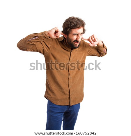 Young man putting his fingers into his ears - stock photo