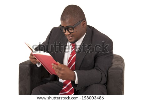 Young man reading a book in chair
