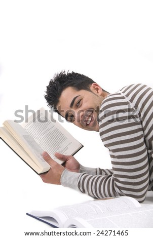 young man reading a book in the floor - stock photo