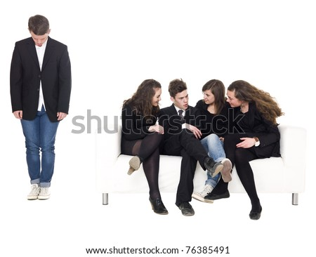 Young man rejected from the group isolated on white background - stock photo