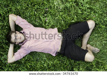 Young man relaxing in grass