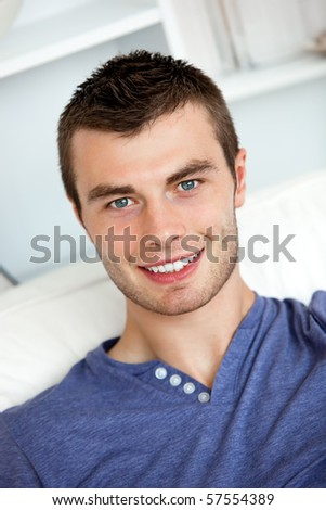 Young man relaxing in the living-room at home - stock photo