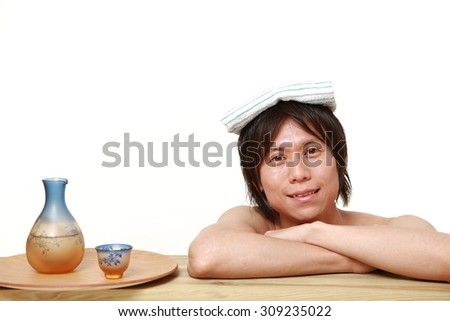 young man relaxing Japanese traditiona bath - stock photo