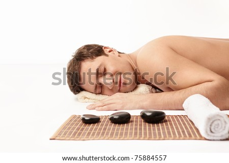 Young man relaxing on a white background - stock photo