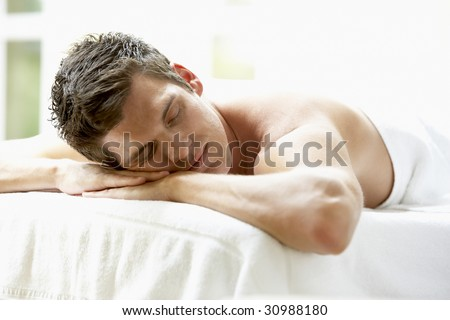 Young Man Relaxing On Massage Table