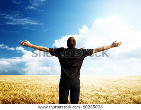 young man rest on wheat field - stock photo