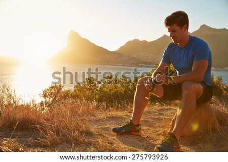 Young man resting after jogging - stock photo