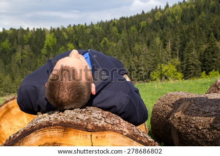 Young man resting in forest - stock photo