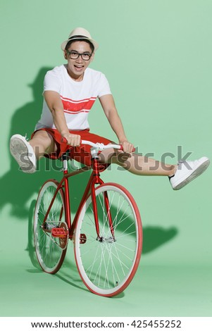 Young man riding a bicycle - stock photo
