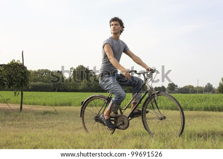 Young man riding a bike in the country