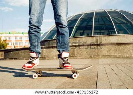 Young man riding a skateboard. Town Square