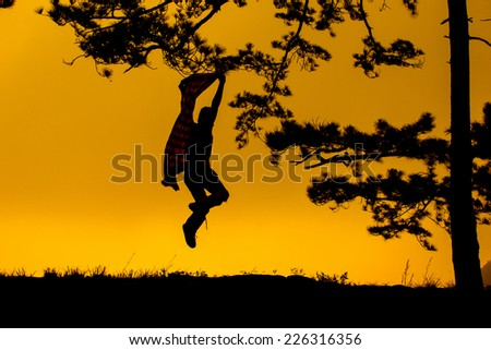 Young man run and hold Fabric for joy his freedom in the nature - stock photo