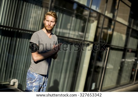 Young man running in the urban area