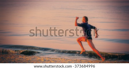young man running on the beach in the morning, blurred background