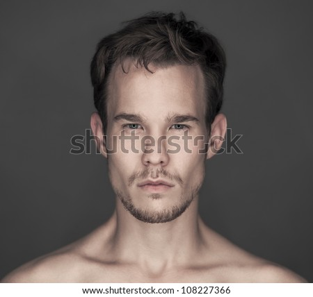 Young man's face - stock photo