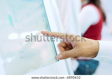 young man's hand touching the touchscreen. Low DOF, focus is on the finger - stock photo