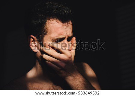 Young man sad and crying