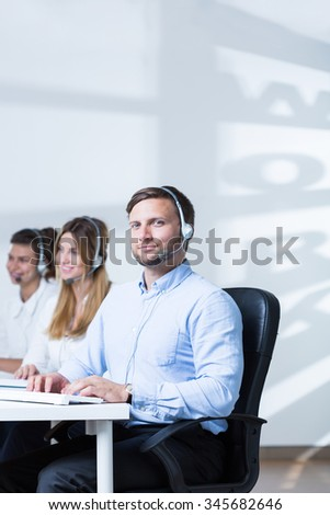Young man sales lots of products of his company  - stock photo
