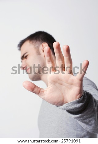 young man saying stop; denial gesture - stock photo