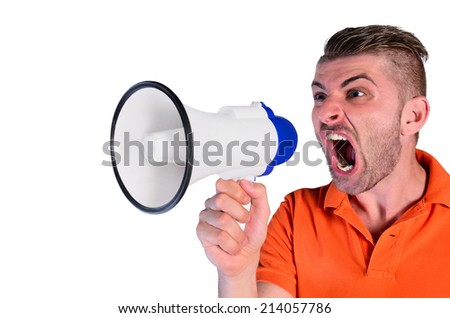 young man screaming aggressive at loudspeaker on white background