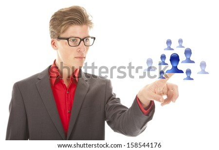 Young man selecting blue virtual friends isolated on white background - stock photo