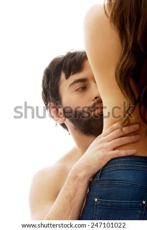 Young man sensual touching slim woman's waist. - stock photo