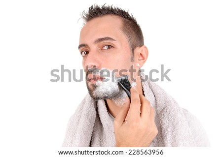 young man shaving his face isolated in white background