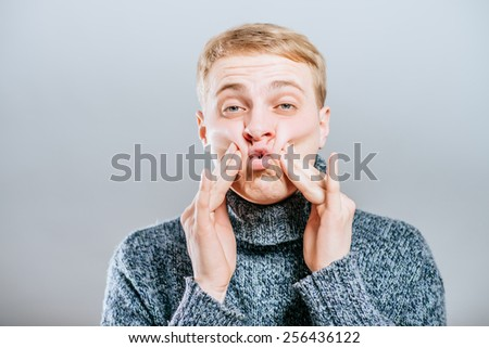 young man shocked tired. Gesture. Close portrait