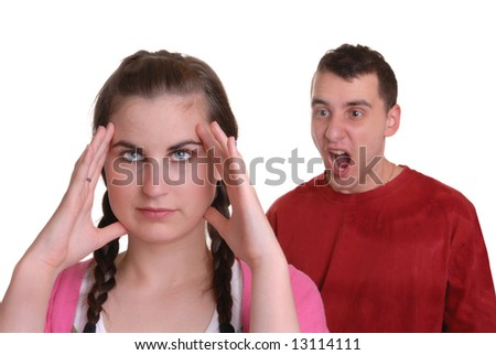 young man shouting at young lady who has a headache - humorous concept, isolated on white